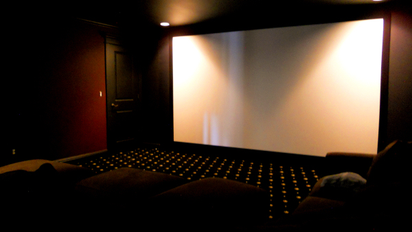 The finished theater is bigscreen nirvana with an eye-popping 139.5″ X 78.5″ viewable image!