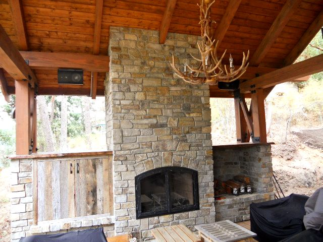The deck fireplace area has Sonos, Speakercraft marine grade speakers, Parasound and an HDTV behind the barnwood doors.